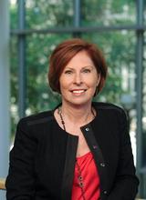 Maureen E Smith